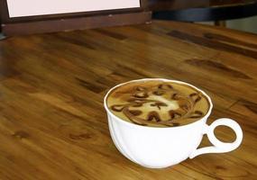 Latte on table photo