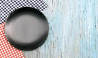 Black plate on tablecloth