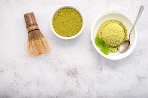 Matcha green tea ice cream with matcha whisk brush photo