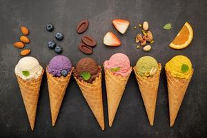 Various flavors of ice cream cones photo