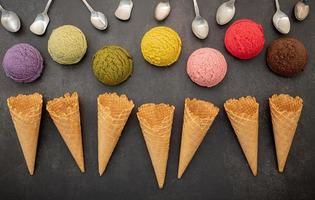 Various of ice cream flavors in scoops with spoons