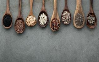 Different types of grains and cereals on shabby concrete background photo