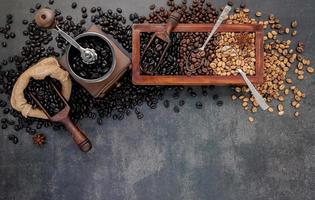 Roasted coffee beans with scoop with manual grinder