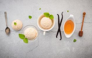 Vanilla ice cream with spoons and decorations photo