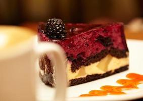 Blackberry cheesecake on plate photo
