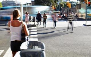 Barcelona, Spain, 2020 - People crossing the road