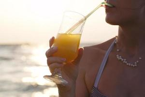 Woman sipping a cocktail photo