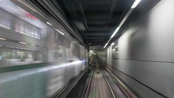 Moving subway train photo