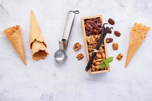 Empty  ice cream cones with mixed nut toppings photo