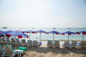 Sunbathing beds and umbrellas in Thailand photo