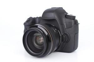 Black DSLR camera on white background.