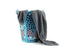 Clothes in a laundry basket on white background