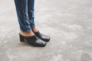 Woman's legs in denim jeans photo