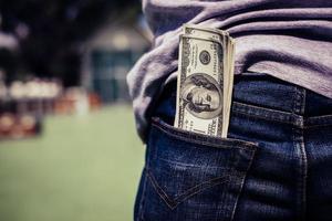 Money in a man's back pocket photo