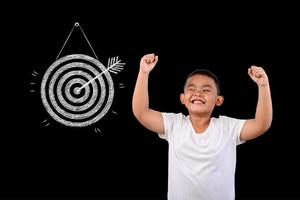 Young boy against a blackboard showing the target photo