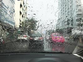 Road view through rainy windshield