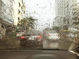 Busy road through rainy windshield