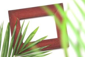 Picture frame and green leaves photo