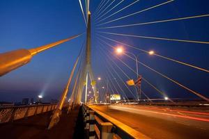 The Rama VIII bridge in Bangkok at night