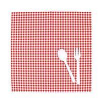 cuchara blanca y tenedor sobre tela foto
