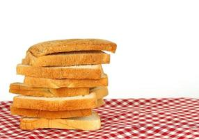 Stack of bred on red cloth photo
