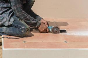 Man cutting tiles