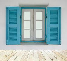 Blue shutters on window photo