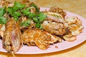 Seafood with cilantro garnish