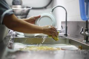 Person washing dishes photo