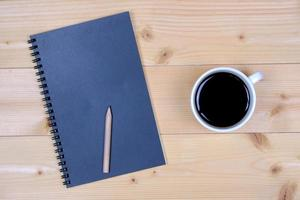 Black notebook and coffee