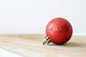 Red bauble on wood photo