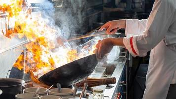 Chef stir frying in a wok