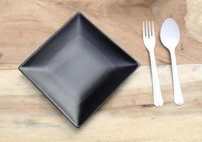 plato negro y plastico foto