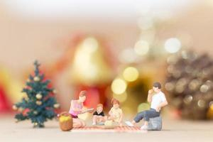 Miniature figurines of a family at Christmas time