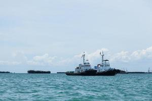 Fishing boats moored on the sea in Thailand photo