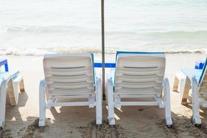 Sunbathing beds at the beach photo