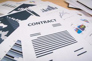 Business reports scattered on table