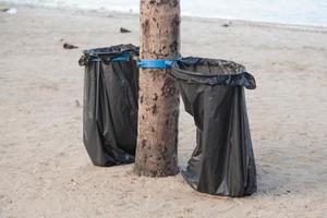 Black garbage bags on the beach