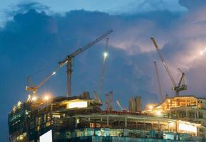 Construction cranes in Bangkok at night