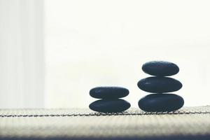 Stack of spa hot stones isolated on white background photo