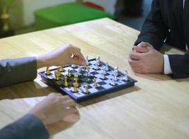 Two people playing chess photo