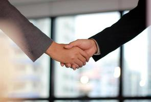 Close-up of a handshake in an office