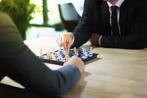 Businessmen playing chess photo