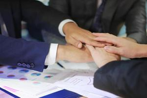 Business professionals joining hands