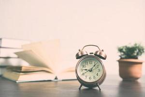 Alarm clock on a table photo