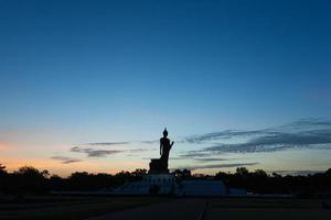 Silhouette of a large Buddha statue in Thailand