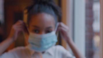 Black girl puts on face mask