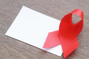 AIDS red ribbon and white paper photo