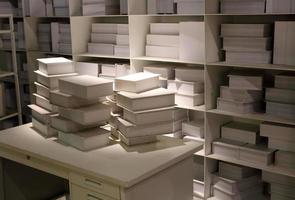 White books on shelf background photo