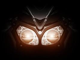 Modern motorcycle headlight with two bulbs photo